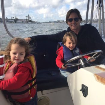Kids Enjoying Electric Boat in Newport Beach